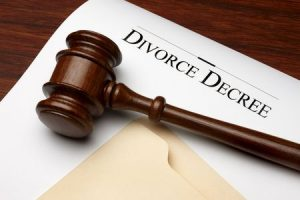 5774322 - divorce decree, gavel and folder shot on warm wooden surface